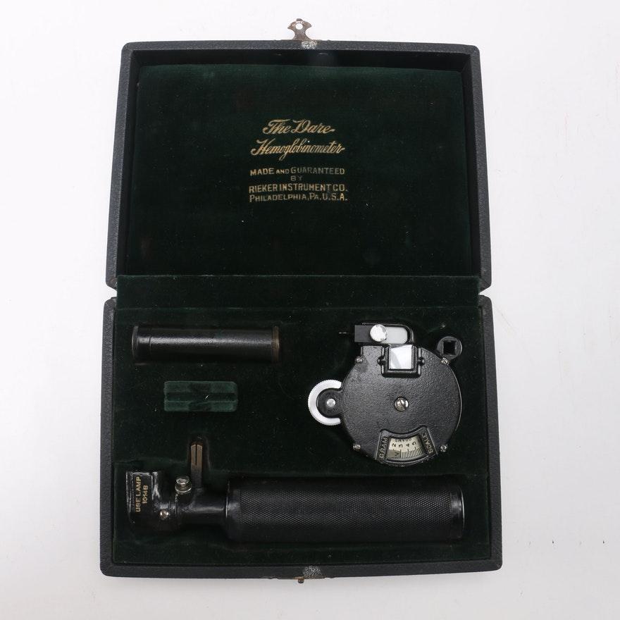 A Rieker Hemoglobinometer in a leather case.